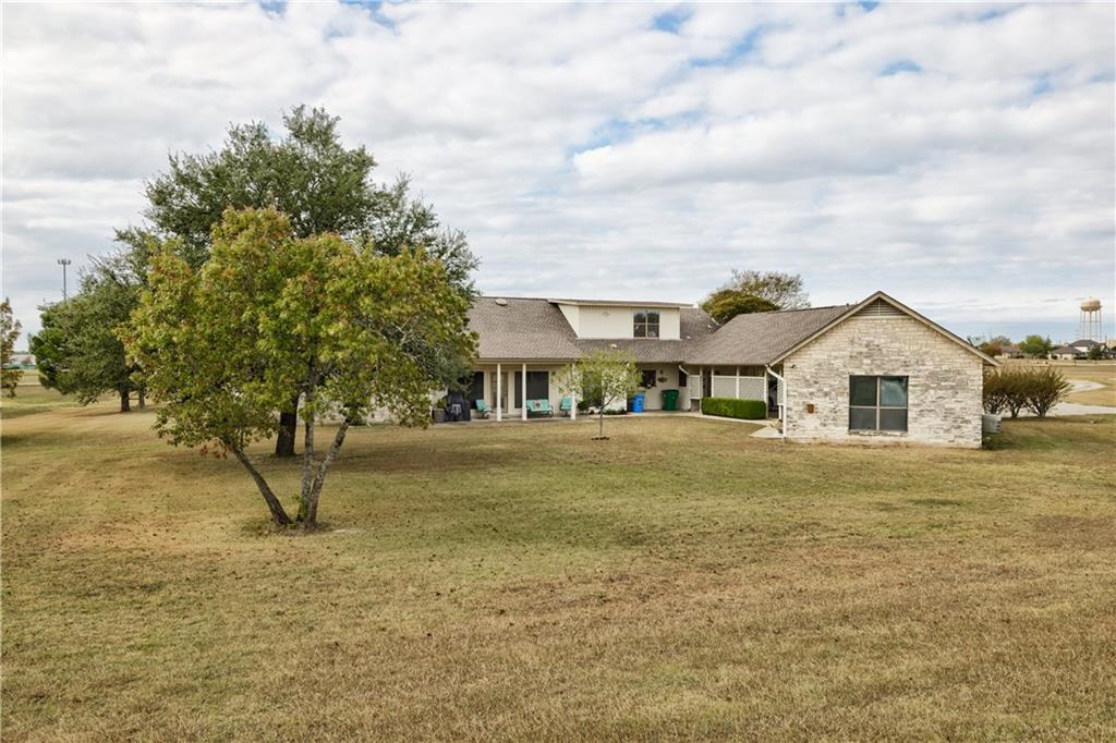 Beautiful family home located on over 5 acres. Good sized living room and kitchen with granite countertops.  A large barn with shop, as well as a separate building with a gameroom makes it perfect for entertaining. House is on septic, but city sewer is available to tap into. This home is a must see.
