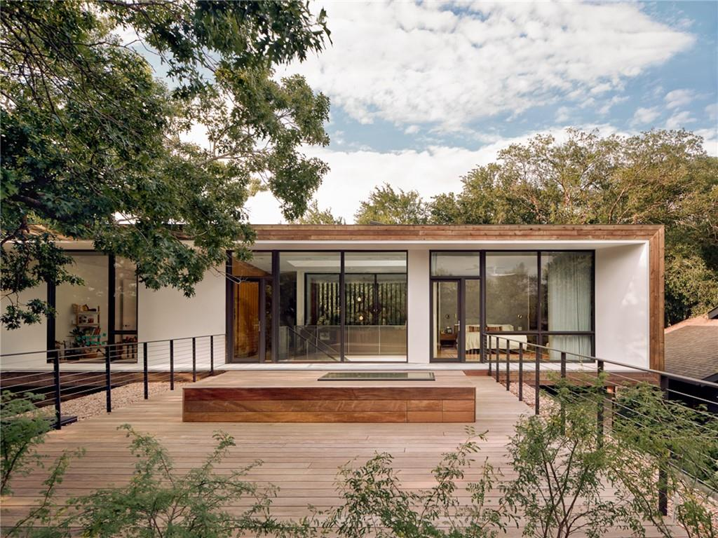 A delicate combination of rustic and modern, 2712 Tether Trl embodies the detail-rich, materially-robust and environmentally conscious design work of locally-famed group Baldridge Architects and award-winning Pilgrim Building Co. Overlooking the natural beauty of the Barton Creek Greenbelt, this home sits on a 0.3 acre lot amongst protected trees and surrounding greenery, minutes to Zilker Park, Barton Creek Trail, Downtown Austin and nearby attractions on S.Lamar and Barton Springs Rd. Feel as though you live in the hill country, yet reside in the heart of town. Thoughtful design offers privacy from the front of the property, yet inside awaits an inviting open layout, with modern lines and steel accents, stained concrete flooring and expansive floor to ceiling windows. Chef and entertainers center-island kitchen with extensive custom cabinetry, state of the art appliances, including a Vertizoni range, and bar and formal dining seating. Kitchen opens to the living room, surrounded by windows emphasizing the incredible view and featuring a true Rumsford fireplace. Beautiful walk-out cantilevered concrete patio extends from the living room, as well as an additional upper-level Ipe deck w/skylight bench, a perfect place to take in the sunset. Elegant flow from room to room, with spectacular finishes throughout:custom walnut pivot front door, white oak hardwood floors, Windsor doors/windows, operable skylight, Brendon Raven Hill Studio fixtures and Mutina tile to name a few. One bedroom plus powder bathroom on the main level, w/two additional bedrooms and master on the second. All bedrooms enjoy privacy and views of the hills. Primary bedroom features custom built-in shelving, hardwood flooring, vaulted ceilings, walk out patio and en-suite bathroom, complete with high-end custom fixtures and walk-in steam shower. Landscape includes native plantings bordered by custom stone and steel framing. Featured on AIA Austin Homes Tour 2019 and Austin Monthly magazine.