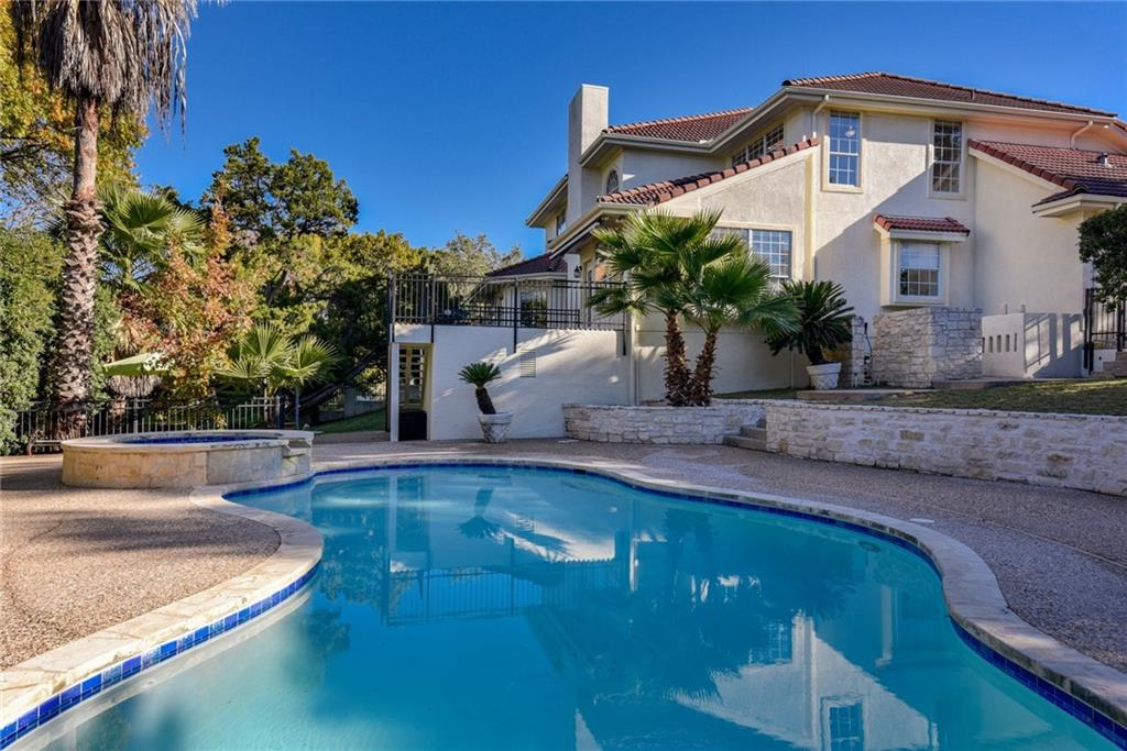 Rare find in The Hills with large, fenced, corner 0.609-acre lot with numerous oaks and in-ground pool/spa (re-surfaced 12/2020). Fresh paint (11/2020) inside (including ceilings, trim, built-ins, doors, walls) and out (including stucco, fascia, soffits); engineered wood floors down; recent LED recessed lights, vanity lights, ceiling fans, pendant lights, Hunter Douglas remote controlled blinds on zones down; Jack n' Jill bath up between 2 spacious guest rooms; 3rd bedroom with separate full bath up on opposite side of game room with built-ins and study nook or extra storage; separate workshop or home gym off laundry area; huge walk-in pantry with space for separate standing freezer or refrigerator; built-in wine fridge off formal dining; formal living or office off majestic foyer; massive family room with towering ceiling and 2-story white stone gas fireplace; kitchen with built-in oven & microwave, gas cooktop, and granite breakfast bar open to the family room. 3-car side entry garage with extra storage space. Storage shed under patio for pool supplies with refrigerator & prep sink. Exemplary Lake Travis ISD schools. The Hills Country Club and golf course offers various levels of membership and social activities.
