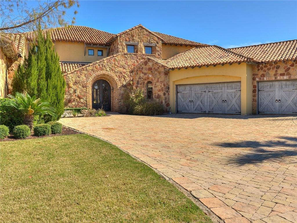 This stunning Tuscan-style estate with a contemporary feel is situated in a wake-free cove of constant-level Lake LBJ in Horseshoe Bay within the gates of prestigious Applehead Island. Designed to take full advantage of the lakeside location, the outdoor living amenities include over 2,300 sq ft of covered patios and feature an outdoor kitchen, stone fireplace, dramatic vanishing edge pool/spa and a boat dock with electric lifts and room for 2 boats and 2 PWC. Throughout the expansive home, the creamy white walls contrast with rich, 100+ year-old barn wood on the beamed ceilings. The wood compliments the hand-crafted iron railings and windowed arched doors as well as the Travertine and Saltillo tile floors. Ceilings are treated as architectural elements, including the impressive brick barrel-vaulted ceilings found in the entry and master bath. This 5-bedroom, 5.5 bath home, which spans over 5,400 sq ft, features an open concept floor plan and seamless indoor-outdoor living, is a true entertainer's residence that will host large friend and family gatherings for years to come. The skillfully appointed kitchen features a custom island providing generous prep and storage spaces, walk-in pantry, Sub-Zero refrigerator and Wolf microwave and Rangetop with 6-burners/griddle. The Great Room features a large stone fireplace as well as a wet bar with beverage refrigerator, sink and icemaker. The master suite is a boasts its own sitting area, porch/lake/pool access, his and hers closets/vanities, jetted tub and walk-in shower. A large laundry room as well as a powder bath complete the functional main level. Upper level hosts three guestrooms each with en-suite baths as well as a loft area which provides an additional gathering spot of bunk space for guestroom overflow. Move downstairs to the lower level where you will find a Murphy Bed and full bathroom which can account for the 5th bedroom.