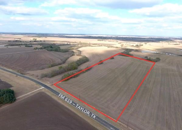 Prime location on FM 619 for development. 17 acres with 572 feet of paved road frontage! No flood plain! Ag exempt for low taxes. 5 minutes from Downtown Taylor & 40 minutes from Austin. Electricty at the street. Water and sewer nearby. Zoned for residential use. Adjoining 36.99 acres available for a total of 54 acres for sale at the corner of FM 619/CR 412. Please verify schools and restrictions with City of Taylor. Come see it!!