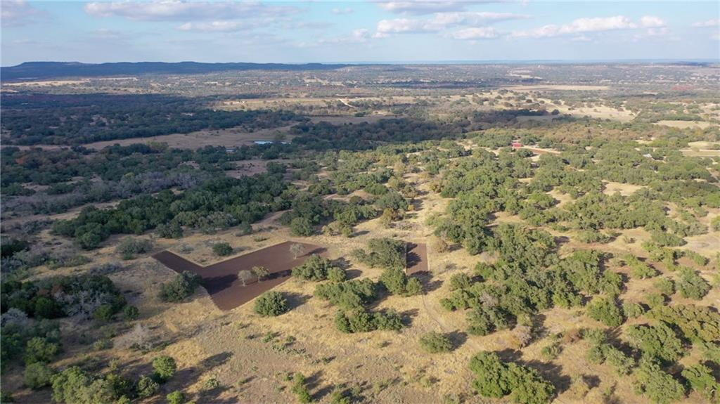 Beautiful Hill Country ranch.  Most cedar cleared, some left around edges for privacy and some left for wildlife protection.  Dry weather creek.  Wildlife exemption.  Three food plots for deer.  Area is well known for trophy Hill Country deer.  Several good potential homesites.  Close to Blanco/Hays county line, minutes from Austin off Hamilton Pool Road.