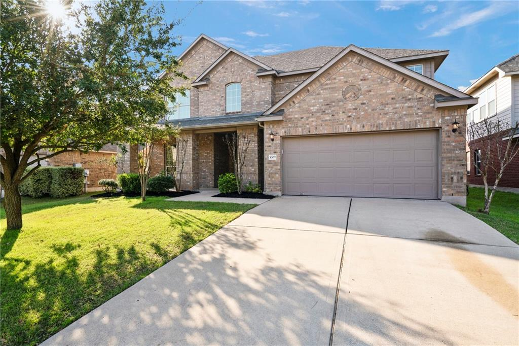 This home has been made new!   Massive home with Master bedroom downstairs, Office, Living area and two dining rooms.  Upstairs boasts 3 full bedrooms with a media room/extra bedroom and additional living space.  Quick Walk to YMCA and Rio Grande and within minutes to the new Hutto COOP.  This home is huge and has been completely redone for a new family, new paint throughout, new floors throughout and ready for someone new to make it their home.