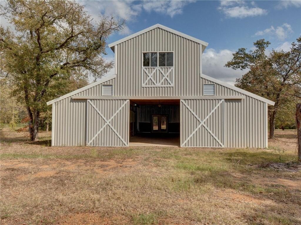 One-of-a-kind property sits on 10.2 Acres. Imagine yourself reclining on the second story 16x12 deck overlooking your pasture. Would make a nice week-end getaway perfect for entertaining or permanent home. Easy access with frontage on two roads. 40 ft x 50 ft. metal/wood frame consisting of 1650+ sq ft. living area 2-bedroom 2 bathroom plus 1350+ sq. ft barn under one roof. 4 premium horse stalls plus wash stall ready to go. Features include vaulted T&G ceilings, spacious bedrooms, spa bath, tank-less water heater, 2 ponds. Property has split A.C. system, aerobic septic, and a 612 ft. water well. Current Ag. Exemption. Beautiful country property with lots to offer.