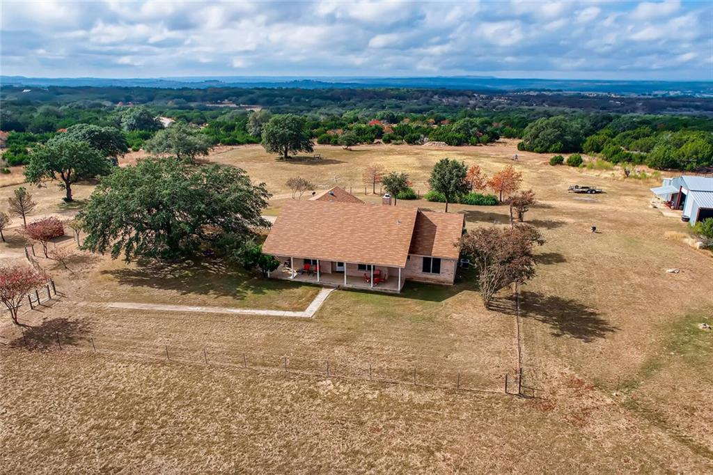 Tucked away in the heart of the Texas Hill Country, this property boasts 23.2 gorgeous acres and a spacious 2602 sq ft. 3-bedroom, 3-bathroom home. This single-story dwelling was built in 1998 and features stainless steel appliances, crown molding, and high ceilings for a breathable space to call home. A stunning 360 degree view of the surrounding area supply's breath-taking views and offers great potential for further development.  This property also features a workshop/storage space, fenced in private yard, and welcoming front porch to enjoy all that nature has to offer in comfort.
