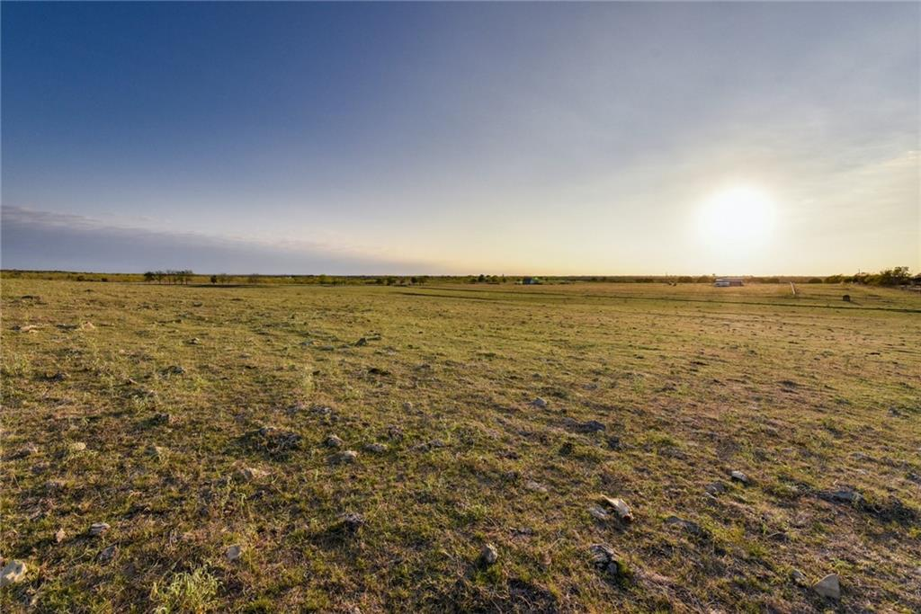 Incredible Hill Country views perfect for your new farmhouse! NO RESTRICTIONS! Build you a barn dominium or a hill country oasis! Endless possibilities with this property that offers the convenience of IH 35 nearby but also the quiet privacy of rural living! Excellent grass for grazing livestock!