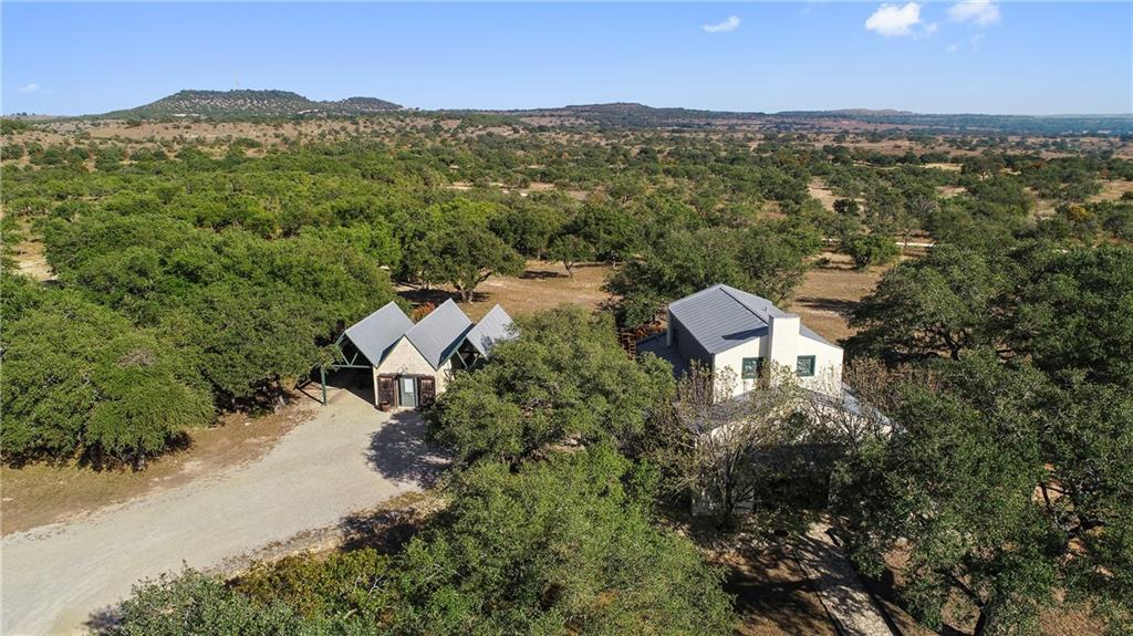 68+/- Acres with Home, Guest House, Barn with stunning Hill Country Views! This private and peaceful property is surrounded by beautiful ranches. Located in the very popular Cypress Mill area. A beautiful remodeled home open kitchen & 3 beds/2 baths. Additional features include a separate detatched studio(guest casita) w/bath, a large utility building, pole barn, irrigated garden w/raised beds  Approx 1400 ft of road frontage on paved Shovel Mountain Rd. Property is ag exempt. Very little cedar, abundance of large, healthy live oaks throughout. Wildlife is abundant. Additional acreage also available. Located 10 minutes from Spicewood, 20 minutes from Marble Falls, 30 minutes from Bee Cave and the Hill Country Galleria, and 45 minutes from downtown Austin.