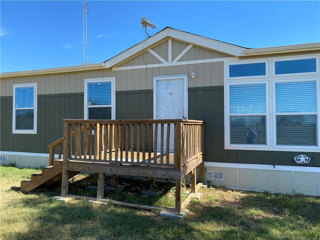 10 acres with 2018 manufactured home located on CR 401 in Dime Box, off of Hwy 21. The home includes 4 bedrooms and 2 bathrooms, with open concept living space. Living room and master suite are spacious. The property is fenced and cross-fenced, has been cleared, and a pond was added in 2020. Extras include an above ground pool, a hot tub on the back deck, an RV hook-up, a storm shelter, and several out-buildings. There is a secondary building that was previously used as living quarters. This space would make a nice man cave or a work/storage area. The property location provides easy access to Bryan/College Station, Bastrop, and Austin.