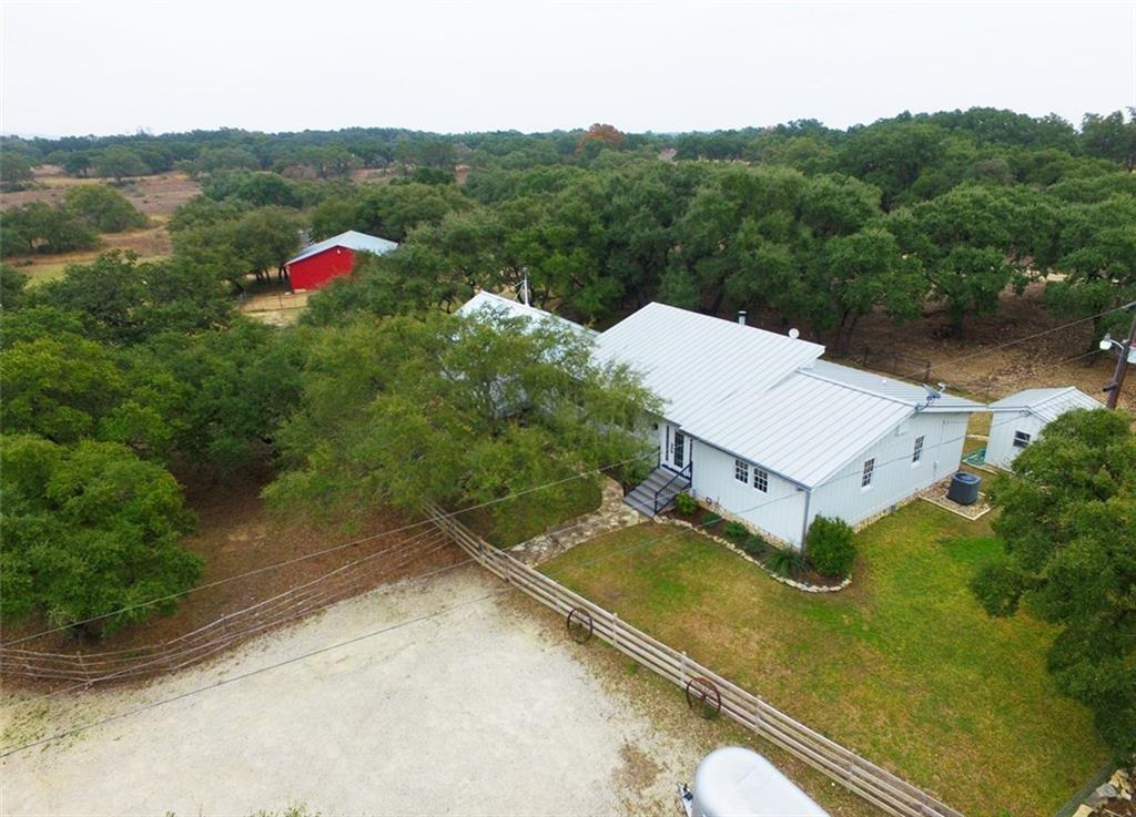 Beautiful Hill Country property conveniently located only 20 minutes from Dripping Springs, Wimberly and Driftwood. 55 minutes to downtown Austin. Agricultural Exception in place! 24.5 acres plus a move-in ready home, horse barn, separate garage and a storage. Appointment only. Agent to accompany all showings.