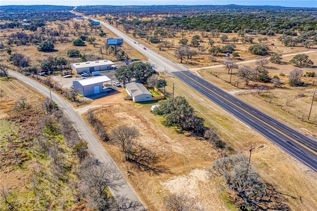 GREAT INVESTMENT!!! 700+ FEET OF HWY 281 ROAD FRONTAGE AND 3 MILES FROM HWY 71 AND 281. THERE IS A 2000 SQFT REMODELED MH THAT IS LEASED FOR 1575.00 PER MONTH. LOTS OF USES FOR THE THIS PROPERTY!!!  ALSO HAVE A PLAN FOR 12 RV SITES AT 400-450.PER SITE A MONTH! HOT AREA!  HWY 281 ADDING A TURN LANE ETC AND 11000 IS NOW THE TRAFFIC COUNT PER TXDOT!  700+ NEW HOMES JUST DOWN THE ROAD AND ANOTHER 900 AT 71 AND 281. HAS A WELL FOR WATER  AND SEPTIC AT THE MH!!!