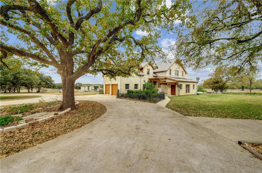 You'll fall in love with the privacy and tranquility of country living within the secured gates of a ranch community, just 40 minutes NW of Austin*29+ Acre gated property with spacious 4 bed/2.5 bath home and amenities including a 5 stall horse barn with tack room and feed room, 70x100' covered and lighted arena, state-of-the-art aquaponics greenhouse, shop garage, chicken coops, rain water collection system and so much more*3,145 sq ft home features a spacious living area with vaulted ceilings and stone fireplace*Owners' suite includes high ceilings, walk-in closet, double vanity, separate shower and jetted tub*Light, bright open floor plan is perfect for entertaining with several doors opening to the wrap-around porch*Kitchen features a large center island, granite counter tops, breakfast area, skylights, updated light fixtures and huge walk-in pantry*Second floor includes 3 sizable bedrooms with recent carpet plus a loft area and secondary living room*Beautiful, cleared pastures with cross fencing ideal for livestock*Native plant gardens and raised plant beds, including 18 fruit trees*Spectacular oak trees throughout the property*980' deep well*Serene neighborhood under wildlife management plan with approximately 10 miles of horseback trails*Welcome home!