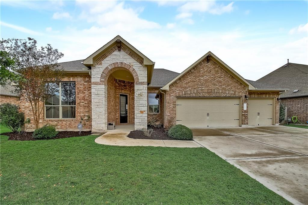 Blackhawk Beauty! Step inside this super spacious one-story home where the kitchen is the centerpiece and every room offers an abundance of space and light. Gorgeous wood floors cover the foyer and main living spaces and only the bedrooms have carpet. The kitchen has a huge center island breakfast bar and SS appliances, including a Bosch dishwasher and Whirlpool gas cooktop, built-in oven, and microwave. Fridge conveys. The master bedroom has a wall of windows overlooking the backyard and the bathroom features an extra-large soaking tub and walk-in shower with a bench. The master closet is enormous! The two secondary bedrooms are separated by a full bath in the opposite front corner of the home. The covered back patio is built for entertaining and has two ceiling fans to keep you cool on hot summer days. The 3-car garage offers extra depth and the driveway is also wide enough for three cars.