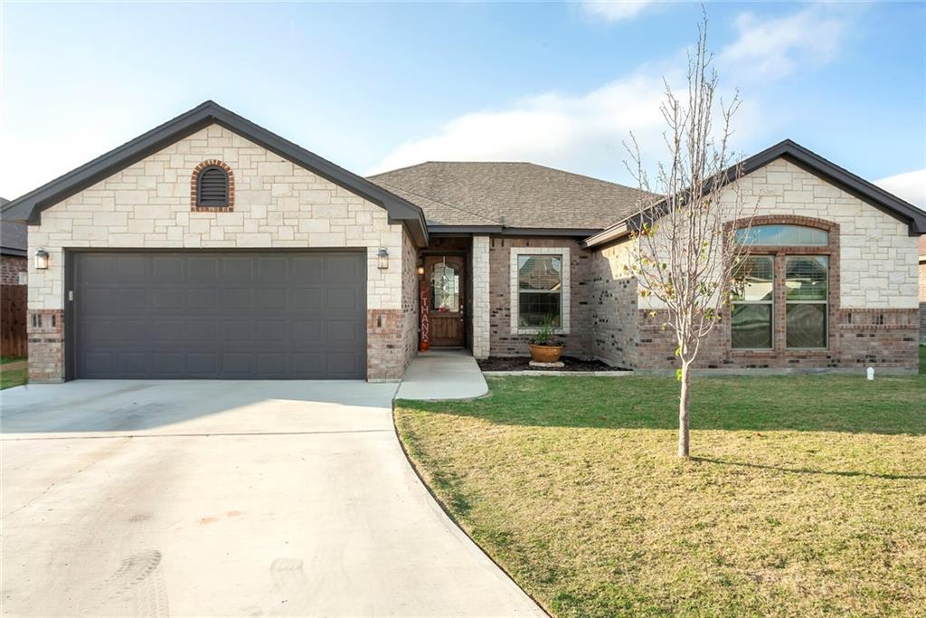 Fall in love with this custom-built 4 bed/2 bath well-kept one owner home in Jarrell, TX.  This home offers a spacious open concept & In-Law floor plan.  The 4th bedroom has a closet and a french door entrance, which could easily be a flex room, playroom, office/study or formal dining.  Plenty of room for working from home or virtual schooling! The kitchen, offers stainless steel appliances & opens to the dining area & living room featuring a beautiful stone fireplace. Primary bath has separate tub & shower + double sinks. Split floor plan w/ secondary bedrooms on the other side of the home.  Home features wood like laminate flooring throughout w/ carpet in bedrooms.  Enjoy the Texas sunsets on the covered patio overlooking a nice sized yard that backs up to the retaining pond with currently no neighbors behind you.  Front & back sprinkler system. Water softener, washer/dryer & refrigerator negotiable.
