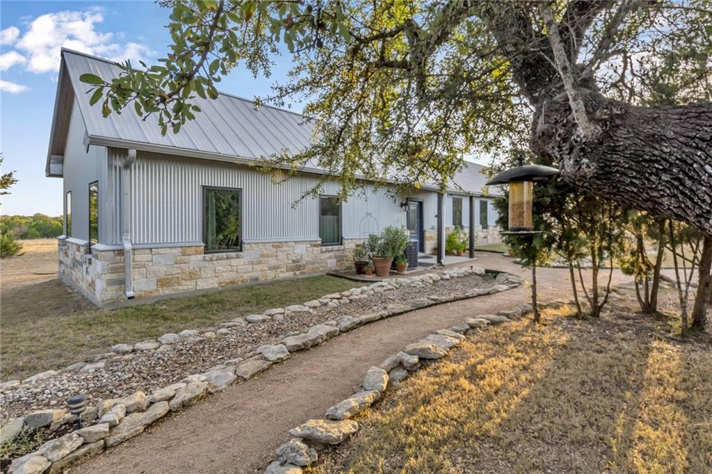 Metal and Rock Home with Guest House on Private 17.55 Acre Tract ~  Metal Life Time Roofs ~  4 car Garage Workshop with half bath ~  Chicken Coop ~ Crushed Granite Walk Ways ~ Deer Roam Freely ~