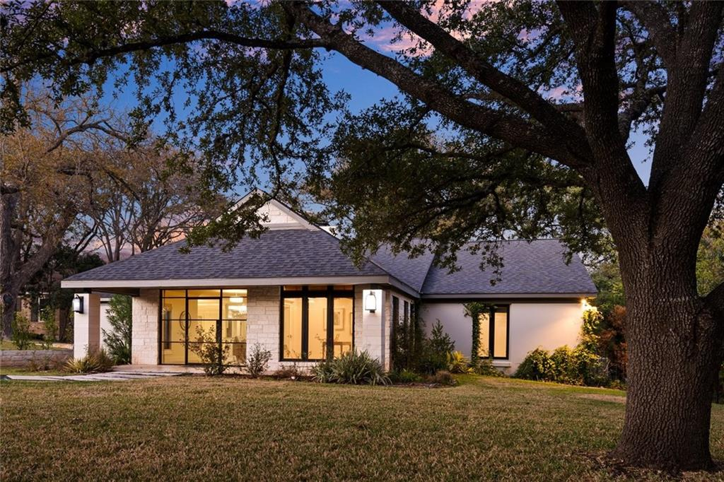Beautiful 1 story modern home in the heart of West Austin.  Half acre lot, backs to Camp Mabry, for extra privacy.  Totally renovated in 2017.  Dual fire place, that has two livings that open to kitchen and dining, make this home great for family gatherings or entertaining.  Garage entry is in rear of house.