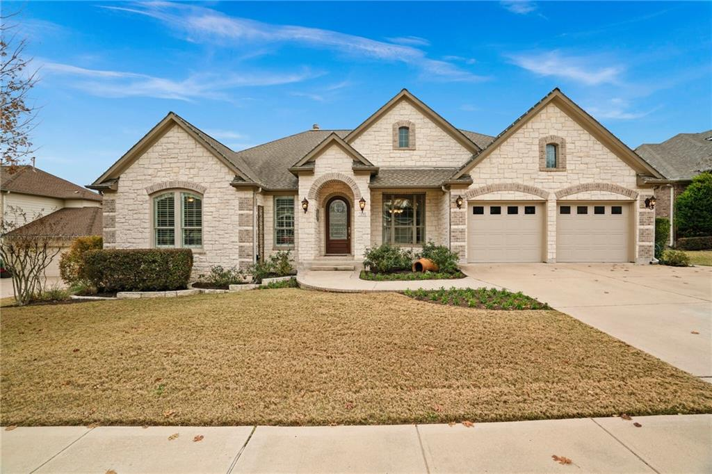 """Exceptional single story beauty in the highly desirable Community of Bella Vista and acclaimed Leander schools! This spectacular, true custom home features magnificent architectural details and high-end finishes throughout. The open floor plan cultivates a social atmosphere with free-flowing living spaces and a Texas-sized game room, complete with wet bar and beverage frig. The custom kitchen design features gorgeous cabinetry, ambient lighting, trending glass tile backsplash, new GE """"Cafe"""" Stainless Ovens and cooktop, huge island with breakfast bar, and another wet bar...truly, an entertainer's DREAM! The private backyard oasis with pristine landscaping, lighting and tranquil waterfall, complete this perfect home! Take a short walk to the Bella Vista Community pool and park area nearby!"""