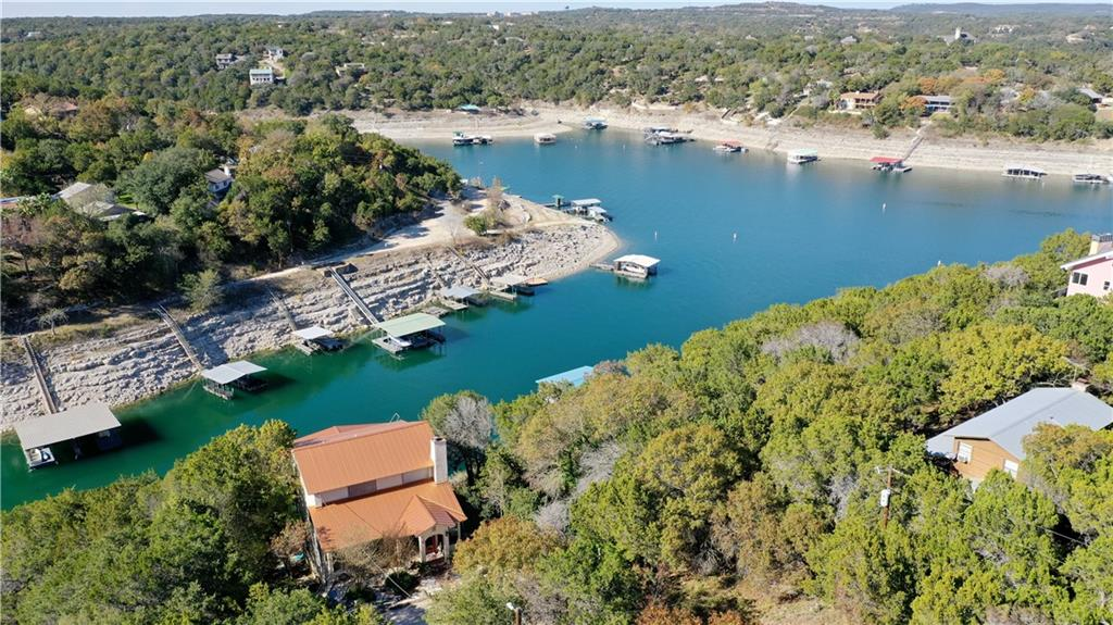 Very charming waterfront home with amazing Lake Travis views! This majestic property sits on over an acre with more than 100 feet of waterfront on a deep water cove, just off Hatter Cove. With large rooms, multiple levels of super-sized decks, there is ample room for everyone. The house cannot be seen from the street, so is extremely private too! The property includes the dock. The boat and Sea Doos are available at an additional cost. If you like the unusual, vintage architecture, and waterfront living, this home is for you! Please call for additional details.
