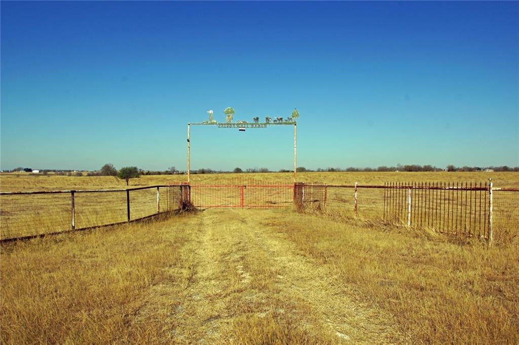 44+/- acres, UNRESTRICTED, AG EXEMPT, with 1550'+/- of FM 973 road frontage in a high growth area in Pflugerville ETJ in Manor, Travis County, Texas. In Pflugerville ISD, has no zoning and has a level to gently sloping topo with improved grass and rich black soil. The water meter is in the northeast corner and is the last meter on the Manville waterline. TXU provides electrical service. The property is virtually floodplain free except for a small .08 ac floodplain area at the southwest corner. Improvements include: 30x60 barn, RV pad, corrals, entrance gate, perimeter pipe fencing and stock pond. Barn and RV pad have water and electrical. Existing septic near RV pad. This property has high visibility from FM 973 and a multitude of development possibilities.