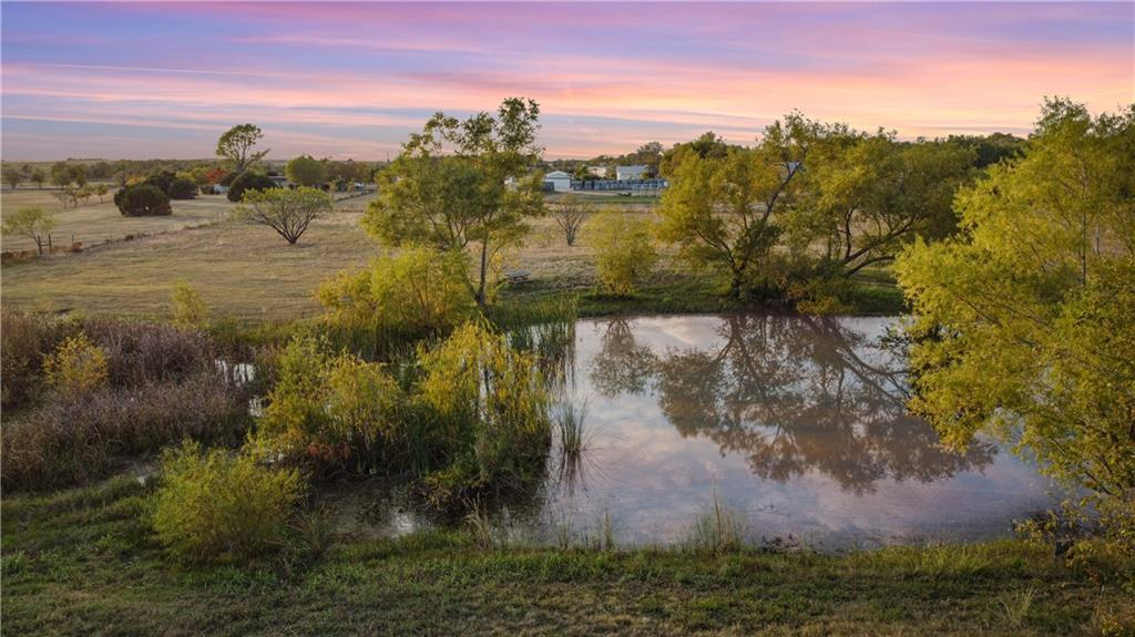 There are 2 houses on this property, and 2 shops on this property, and several workshops/storage buildings. 1 pond with fish. Ideal location in Southeast Travis County, close to Buda or Slaughter Lane! The area has unlimited potential!