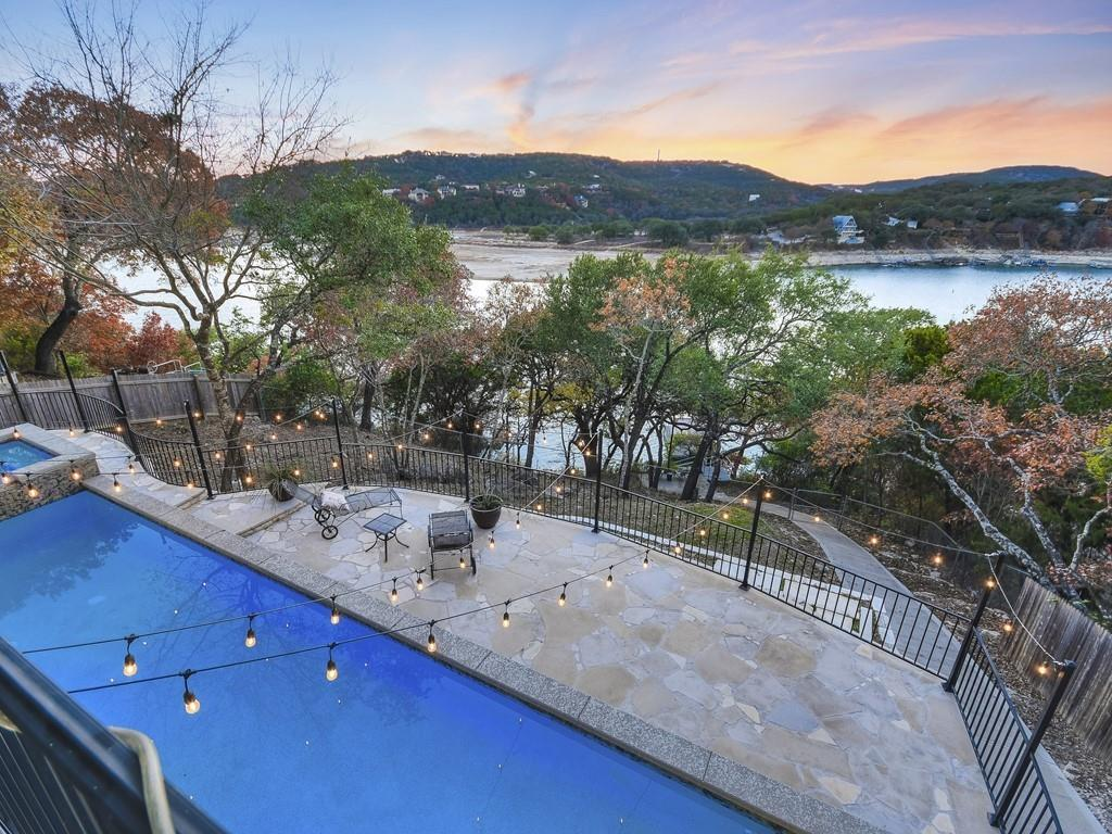 A Lake Travis waterfront beauty in Trails End. This 3/2 features gorgeous lake and Hill Country views from nearly every room, including walk-out Balconies! Built in 2014 with energy efficient materials and insulation. Hardwood cabinetry throughout. Granite countertops in kitchen and all bathrooms. Stainless Steel appliances, including a 36 free-standing oven/cook-top. Ceramic Tile, Carpet and Stained Concrete flooring. Outdoor living at its best. This home features a spacious upstairs, covered balcony with recessed lighting, ceiling fans, Trex Deck and Gas Grill. Downstairs, enjoy a 10 x 40 Lap Pool with Spa. Dock comes with a Self-Adjusting Steel Stair System for easy and safe lake access. Removable handrails and racking system. Surf boat cradle and lift system. PWC float and 4 x 8 dock storage.