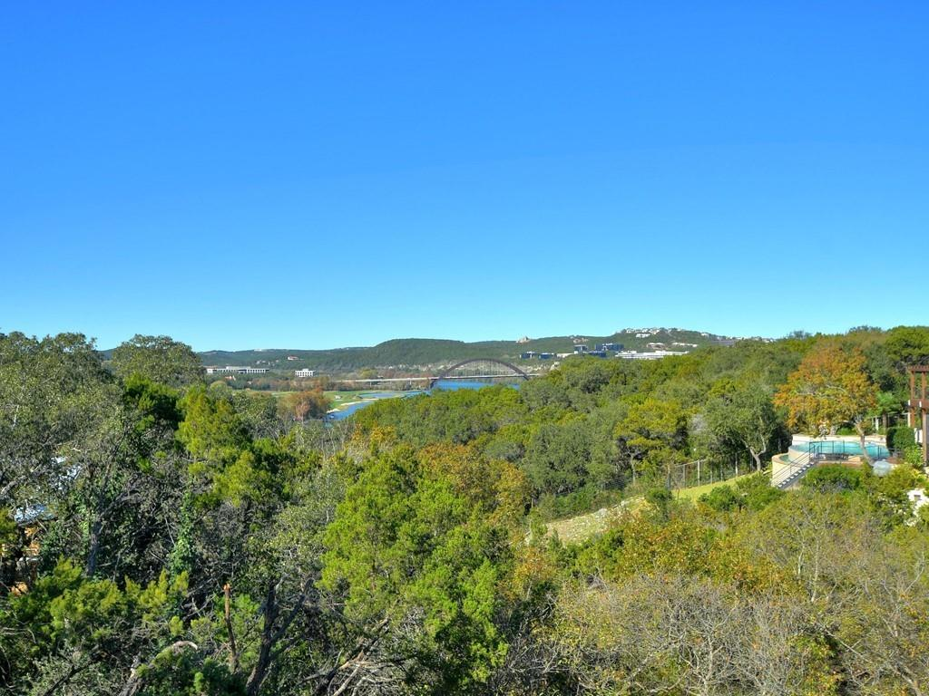 With beautiful views of Lake Austin and the Pennybacker Bridge, a unique development opportunity on 0.34 acres awaits! The current house is a developer's dream located on a quiet cul de sac. Remodel the current floorplan or tear down and build to compliment the breathtaking views of this private getaway nestled among the trees. This property also includes a boat slip on Lake Austin.  *Square footage from TCAD.
