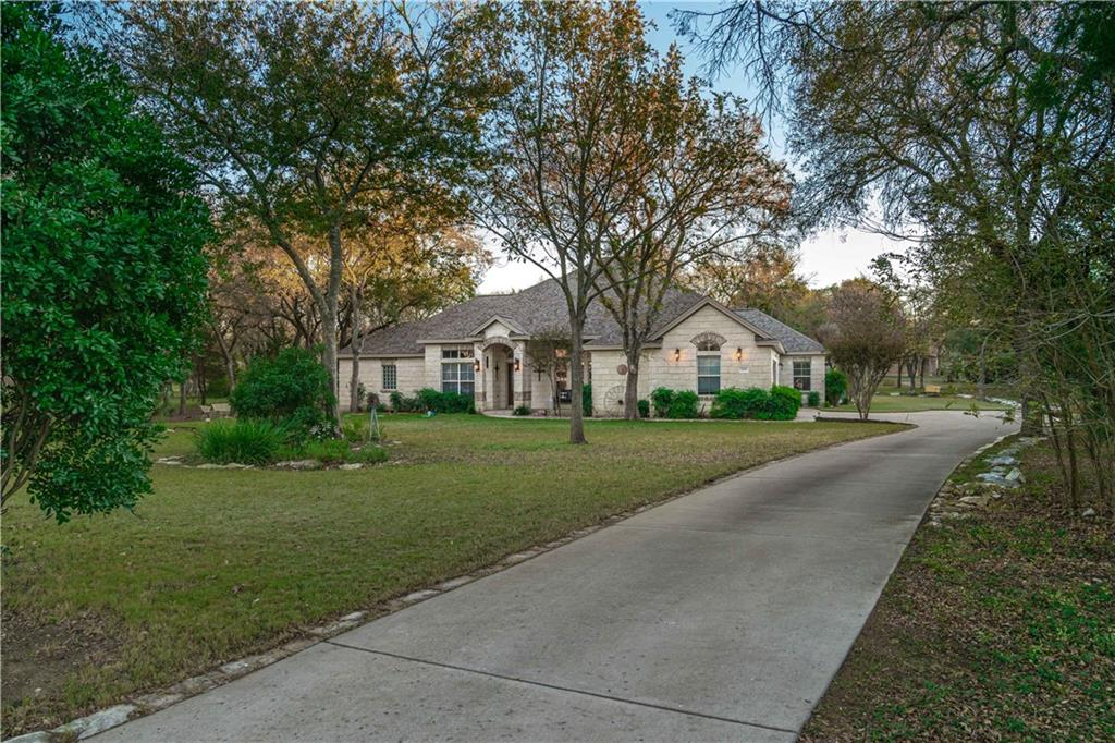 This beautiful home built in 2004 has 4 bedrooms and 3 full baths.  There is carpet in the bedrooms along with travertine tile and hardwood flooring in the other areas of the house.  Granite countertops with island and a built in desk in the kitchen.  Very spacious primary bedroom and bath with a garden tub and walk-in shower!  The breakfast area is just off the kitchen and a beautiful formal dining room is just to the right when you walk in the front door.  Large living room with a built-in stone fireplace along with custom built wooden book cases.  The house is illuminated naturally through large bay windows throughout the house.  Fully covered back porch offers a place to sit and enjoy 3/4's of an acre of trees and the wildlife that is prevalent in the area.  Outside entry to the spacious laundry room that includes a laundry sink.  All bedrooms have large walk-in closets for plenty of storage for all seasons of clothing.