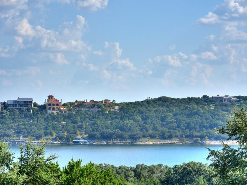 If you are looking for a location that has great features, this may be the one. Located on a quiet qul de sac with beautiful  Lake Travis views, backs to the golf course, within walking distance of 2 waterfront parks and blocks to a boat launch. This home has so many quality features , it is hard to cover them all.  The  3 bedrooms could be 4 if you wanted the office for a bedroom?  Large Media room has coffered ceiling and is large enough to add  a projector . If you enjoy your time in the kitchen, you will love this one. Double built in ovens, one is convection , glass cooktop, wine fridge, farmhouse sink, views of Lake Travis from wall of windows, breakfast bar seats 4 or more, granite counters, big walk in pantry lined with shelves for tons of storage space we always need, customized cabintry with scattered glass fronts and custom lighting. Floor plan allows open areas that makes  entertaining so enjoyable.  Many more features you will just have to make an appointment to view?