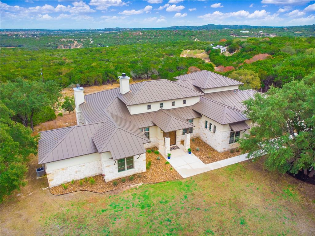You'll love this stunning Modern Hill Country home in a quiet location. This luxurious 5 bedroom, 3 full and 2 half bath, custom built home rests on 10 acres with 180 degrees Hill Country Views. Boasting an array of thoughtful finishes throughout this open floor plan layout. This immaculate 4124 SF home includes bamboo floors, spray foam insulation and LED motion sensor lights. The open living concept allows for ease of entertaining while preparing meals in the gourmet, cook's kitchen. It offers an oversize island with prep sink and storage, soft close drawers, stainless appliances, dual oven, and gas cooktop. Storage under the stairs makes for a large pantry just off the kitchen. A luxurious owner's retreat with jetted tub, dual vanity, and extended shower with dual rain shower heads is the perfect place to unwind. The spacious walk-in closet can also be used as a safe room. Four additional bedrooms and a half bath are on the main level. Upstairs offers a large second living space with half bath. A large covered patio with a fireplace overlooks the rear of the property and is perfect for entertaining with an outdoor kitchen or while sipping on a glass of wine while enjoying the breathtaking sunset view.