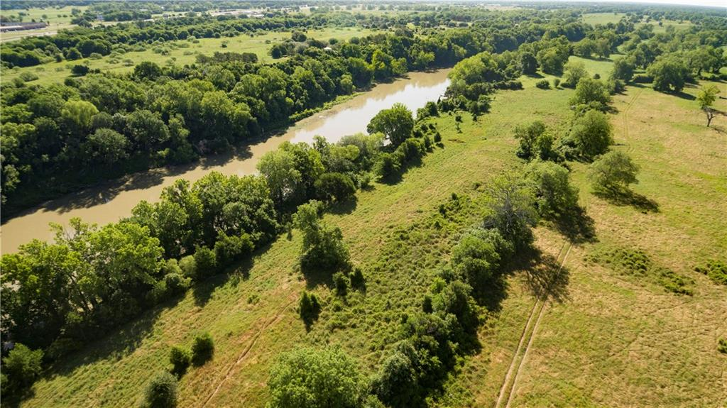GORGEOUS riverfront property just 2 miles from downtown Smithville.  2654 ft +/- of riverfront view.  Conveniently located 5 minutes from restaurants, grocery stores and Smithville schools.  PARADISE ON THE RIVER STARTS WITH THIS PROPERTY! Magnificent potential to build a sprawling dream home with a view of the Colorado river.   FM 2571 road frontage of 2124 ft +/- and 7,000 ft +/- frontage off Hidden Shores road.  Living is easy on this property with trees and views this lovely!!!