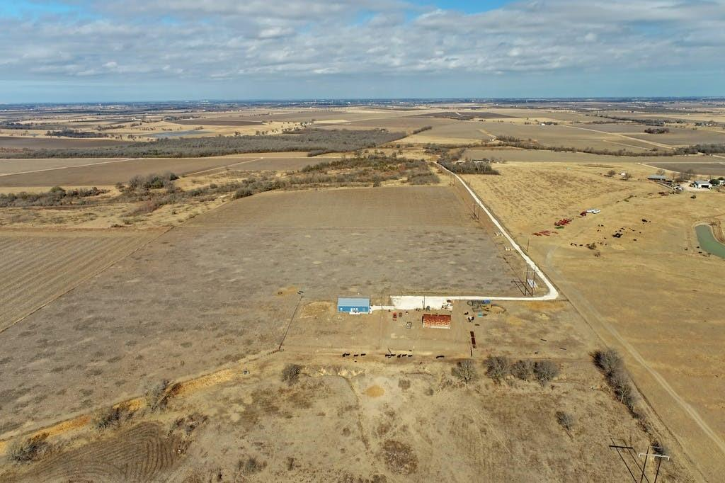 Amazing opportunity. 37.86 acres of AG Exempt private farmland with 2018 build barndominium style home. The home offers 2400 square feet with three full bedrooms, Two full baths and open kitchen and living space. Home comes with a very spacious workshop / office. Land comes with a separate 1500 square foot barn. Walk out to the side patio and enjoy the beautiful Texas sunsets. The home is fully fenced. Own your very own Texas farmland today! One hour show notice to seller.