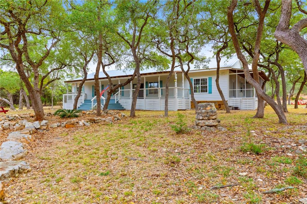 beautiful recently updated single level farm style inspired home featuring 6 bedrooms, 3 bathrooms, multiple living spaces and boasting approx. 2,915 SF. The property offers numerous majestic Oak tree's, privacy, seclusion and sits on approx. 6.58 acres with little to no restrictions. Also included with the home is a brand new aerobic septic system, and a detached workshop that could be the perfect home office! Interior of the home offers fresh paint, recently updated kitchen, updated light fixtures and much more! Relax during the day on the large covered front patio, and enjoy the evenings on the large screened in porch. This home has size, acreage, privacy and seclusion! Contact us today to schedule a private showing, Welcome home!