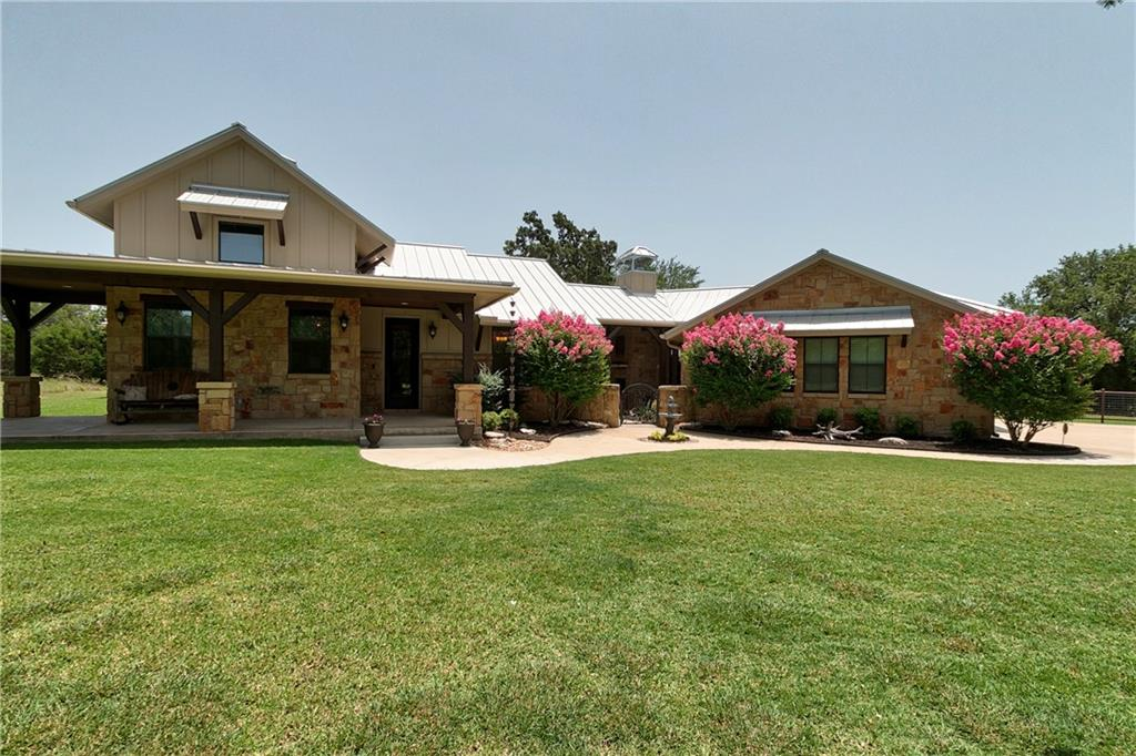 Masterfully designed custom home on 3.99 acres in desirable Escalera Ranch. Well appointed home w/architectural craft*Fir beams & extensive stone work*22 ft ceiling featuring cathedral beams in living and dining*Luxurious master bath w/copper soaker tub, dual walk-in shower*Enjoy a private, large lot with plenty of room to roam or add-on*Detached guest bedroom w/full bath and fireplace*Plenty of patios to watch sunrise & sunset w/fireplace*Outdoor Kitchen & Shower*Fenced yard*Foam Inslulation*Par 3 Golf Hole*500yds of trails*Wildlife! Highly Acclaimed LISD!