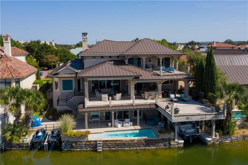 "Located in a quiet cove of beautiful Lake LBJ in the guarded community of Applehead Island, this house embodies indoor/outdoor living.The lake placement in a No-Wake Zone of the flat, uniform cove allows for expansive lake views & useable water space.American Clay walls on main floor & MR ceiling.Big Ass Fans in LR & Primay BR. 3M Window Film on back windows to significantly reduce heat & UV transfer. Hi-Volume Programme Martin closet system added to Primary Closet. Gas Log Fireplace w/remote starter.HIGH SPEED INTERNET!!!!Whole House Audio-Sonos System App controlled music system with 7 indoor/outdoor zones w/speakers.Drinking Water Purification System.Office Desks & Shelving in main floor bedroom.Bookcases in utility hallway. Large Pantry w/shelving below stairs near kitchen.Full size Sub-Zero Refrigerator in built-in cabinet in laundry room.Custom bookcases in utility hallway. Total Remodel of Media Room to create professional quality music & entertaining space. Large storage area w/built in shelving under outdoor stairs in Media Room.Control4 Computer Controlled Lighting System capable of upgrade to control remainder of smart home controls.Sony A9G 77""Master Series OLED 4k Ultra HD w/High Dynamic Range Smart TV w/Acoustic Surface Audio Plus. Adj Shelf Storage & mini split AC unit in INSULATED garage wall.Full size Sub-Zero Freezer & Double-door, temperature & humidity-controlled Wine Storage Cabinet.Two sOmfy awnings on main level deck (automatic open/close sun & wind sensor & handheld remotes).Landscape irrigation w/ lake water system installed.Shelving, clothes rods, & cabinets in boat closet.Big Ass Fans in Outdoor LR & Outdoor DR. Hydraulic Sunstream Jet Ski Lifts with center deck. Low-light fixtures on main deck railing posts. High Performance Lift, larger hoist cable, wireless remote, and auto up/down limits. Outdoor kitchen w/ TEC infrared grill, two-tap Kegerator, double burner, ice machine, refrigerator, drawers, cabinets, outdoor bar."