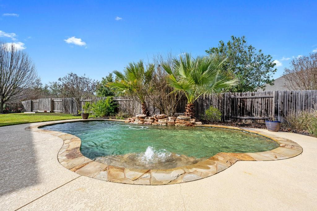 """GORGEOUS .27acre corner lot home with in-ground pool in the desirable Forest Oaks neighborhood and Leander ISD school district.  The master is on the main level and there are three additional bedrooms upstairs with a jack-n-jill bath!  The master has a large walk-in closet with a separate shower and garden tub!  The kitchen has a lovely center island, built in oven and microwave, lots of cabinets and a large pantry area off the laundry room!  Don't miss this!  The additional sitting area off the kitchen could be a lovely """"sun room"""", additional living area or whatever you would like it to be!  Make it yours!  Your family will enjoy the extra-large game room for a """"third"""" living with several closets for lots of storage room!  Recent carpet installed December 2020 and new water softener installed 6 months ago!  If you are looking for a home that keeps everyone entertained; this is your home! Lots of living space and a beautiful pool with a waterfall for your outdoor entertainment!  This active community has two pools, three playscapes, community center, basketball court and a hike & bike trail. Close proximity to shopping, dining, entertaining and feeds to esteemed Leander Independent School District.  Easy access to Parmer and also 183A!  Don't miss this one!  It will not be on the market long!"""