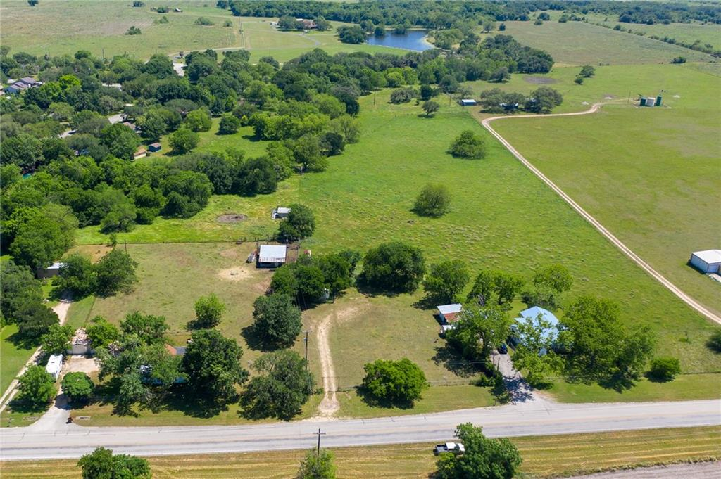 Great opportunity to purchase 14.6 acres of land right on State Park Rd within minutes of downtown Lockhart. Property includes 2 bedroom, 1 bath home with detached workshop/garage, barn for livestock, hay, etc, fenced for cattle or horses. Great potential for development or to keep as is to be close to town yet have room for livestock. Property has city water and sewer. Property has ag exemption and according to City of Lockhart the parcel is in an area designated as future low density residential on the City's land use plan map but can be rezoned upon application by the owner to whatever classification is appropriate for the proposed land use.