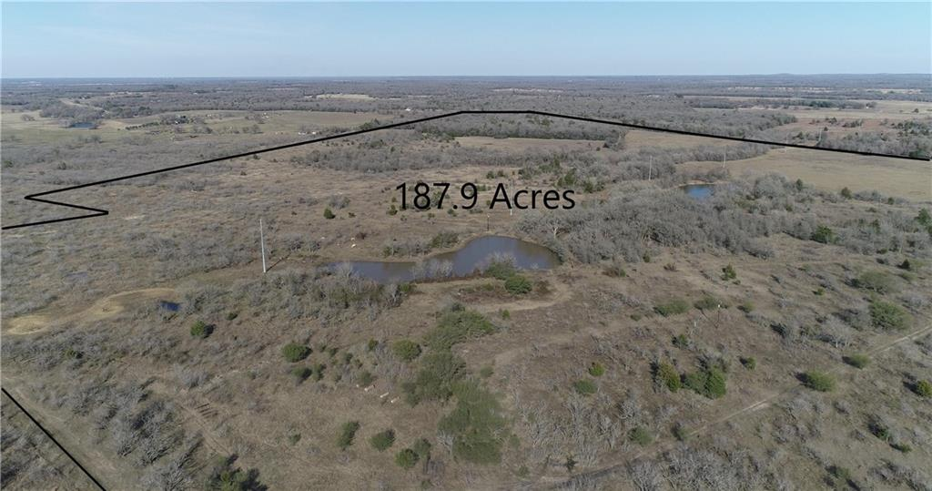 This land encompasses the 3 main ambiances a buyer wants: open pasture, wooded acreage, and surface water PLUS 2 large ponds, plentiful wildlife, panoramic views, & future home-sites or farm/agricultural land use. Located just outside of Rockdale city limits. Within an hour from Austin, Temple Bryan College-Station. City utilities available but NO city taxes. Undeveloped property, no restrictions except located in Rockdale ETJ.