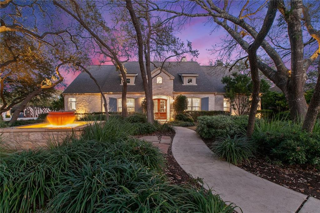 Welcome to this gorgeously appointed home located in the heart of Bee Cave. With hardwoods, high ceilings, amazing beams, a stone fireplace with built ins, an updated kitchen and tons of natural light, it's just stunning. Within walking distance to shopping, dining, grocery stores and everything that the Hill Country Galleria has to offer, this is a special spot. The great room features beamed ceilings and a grand stone fireplace with built-ins for added character. A wall of French doors invite tons of natural light in to the living room. The well designed kitchen offers a fiver burner gas cooktop, double stainless ovens and a layout conducive to entertaining. The primary bedroom is on main level with tall beamed ceilings as the focal point and a door to the covered back patio for convenience. Two more secondary bedrooms downstairs share a Jack and Jill bath and a sunny flex room can be used as an office, home gym or nursery. There is also an extra private multi-use bedroom on the 2nd level with a large closet and full bath. There's ample covered seating on the back patio with gorgeous views of the professionally landscaped backyard.