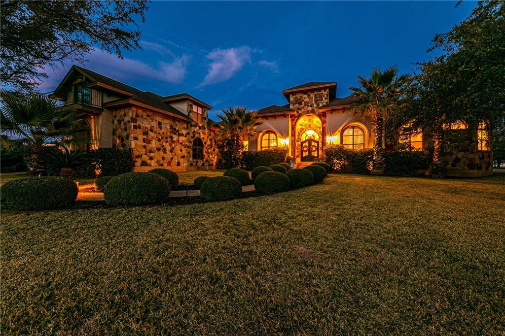 This custom-built estate offers a rare opportunity. The home is sited on a gentle rise offering spectacular sunset views. Gorgeous custom features welcome you at every turn. The foyer is entered through Cantera wrought iron double doors. Tile with a custom inlay in the foyer and scraped wood floors extend throughout. Ceiling treatments include 12 ft. heights in main living areas with custom detailing in the library, dining room, main bedroom, living room and kitchen eating area. There are diamond finish accent walls and generous stone accents which always elicit compliments. The large gourmet kitchen is sure to impress with professional Viking appliances, beautiful custom cabinetry, granite countertops, wine cooler and breakfast area. Three bedrooms, 3 1/2 baths, a formal dining area and a separate office are located downstairs, with an additional huge bedroom/bonus room upstairs. Complete with full bath, massive storage closet and separate balcony, the bonus room could be used as second master suite, MIL plan, or any number of possibilities. Relax on the immense covered veranda with large outdoor kitchen and enjoy the most breathtaking sunsets you've ever seen. Surrounded by a 10-acre property on one side and 1 acre custom homes, the home is privately gated and is a true sanctuary with no HOA. The 3-car attached garage has extra storage, with 3 additional garage spaces on property. Home sits on 3.3183 acres, with purchase including additional 1.6787 acre plot, for a total of 4.997 acres. See extensive list of features and upgrades. Home has been pre-inspected and is ready for the discerning buyer. Agent has familial relationship to seller.