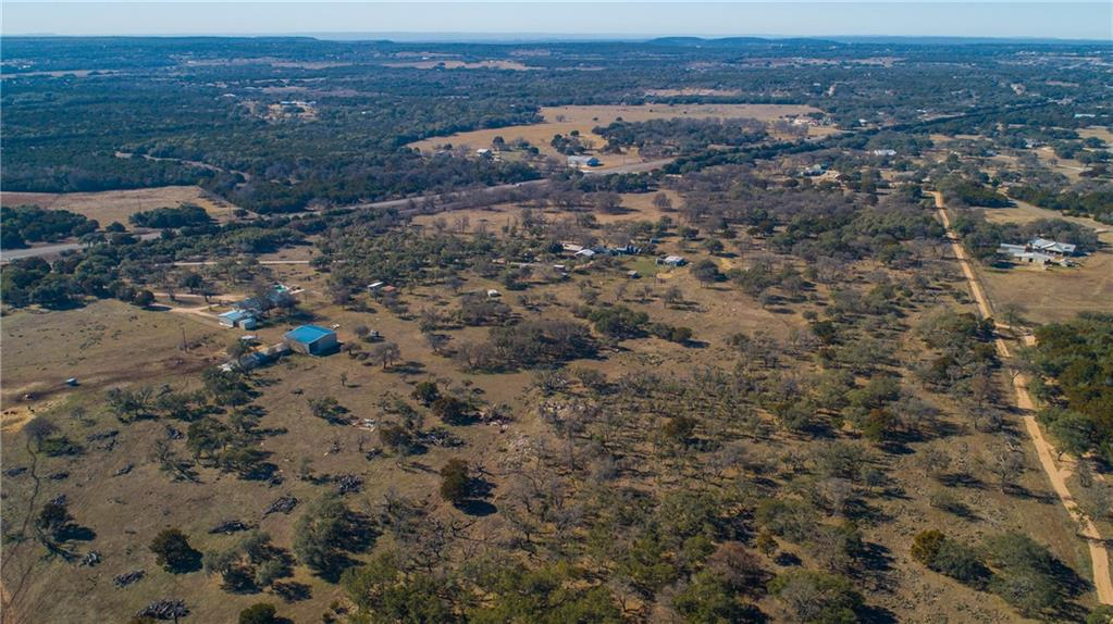 Enjoy the best of both worlds at this incredible 68 acre property, located between Burnet & Bertram. Less than an hour from Austinand just a short drive from the chain of the Highland Lakes, this ranch is one of the hill country's best kept secrets! With nearly 50acres of pasture land, improved grasses, Spanish Oaks, Post Oaks and Elm trees - this land was the perfect set up for a goat breeding operation. Prime SH 29 frontage - this property could be used for either commercial or residential purposes. The main home is approx. 1500 Sq. Ft. with 2 bedrooms/1 bath. Additional building used for office. Must be seen in person to realize the potential value in this location!