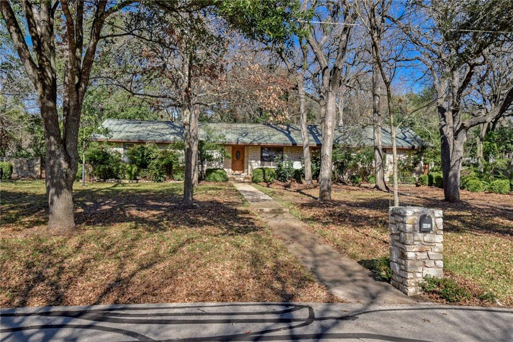 Rare opportunity to own a private, established yard in the heart of Round Rock on .73 acre. Ranch style home has metal roof, XL front porch and is nestled under a canopy of mature trees with a side entry garage. Interior has floor to ceiling rock fireplace and original architectural wood beam across ceiling. Some updates, but plenty of potential to make this into your own custom dream property. Backyard is lined with stone sidewalks and gardens galore. Water well on property is used for yard irrigation, but home is connected to City water. Award winning RRISD. Close to parks, shopping and major arteries. Hidden gem in Round Rock!