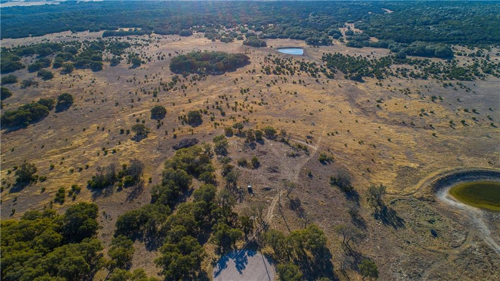 17.47 beautiful acres in the gated community of Blackbuck Ridge.  Build your dream home in the Central Texas Hill Country! Nice level building area with a gradual slope behind the lot. All 17.47 Acres are useable! Majestic oaks surround this lot. Property is ag-exempt - Herds of Blackbuck deer roam the area - and other wildlife.  Property has a 10 GPM well and 320 amps of electric service installed.  You can build a barndominium here and live in your RV while you are building. No required builders.  15 minutes to downtown Burnet or Lampasas. Gated Community of nice ranches. The stars at night are beautiful in the remote, quiet area.