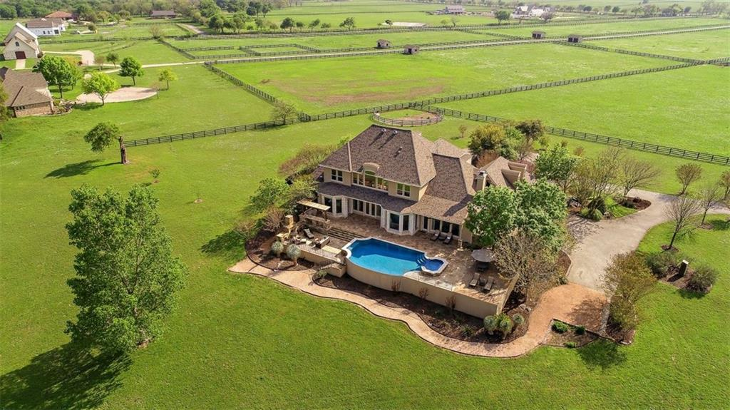 Nature and elegance merge seamlessly at this remarkable riverfront equestrian estate.  Surrounded by 14 acres this is country living for one with sophisticated taste. 10 minutes from historic Georgetown, this unexpected treasure on the San Gabriel River is part of a gated community with less than 10 homes, offering a private oasis from city life. Beautiful green pasture lined drive sets the tone of peace and serenity as you approach the grand residence. Once entering, breathtaking views of nearly 500' of riverfront are showcased by the wall of windows in the two-story living area. A library, formal dining room in the front of the home while the master suite is situated on a separate wing.  The gourmet kitchen features huge center island with storage, a Wolf commercial range containing six gas burners, a griddle and double ovens as well as a sub-zero type refrigerator. Large dining area overlooks the back patio and expansive views. Open to the kitchen is the cozy family room with a back staircase.  Upper level includes a game room, four additional bedrooms and four full baths, three ensuites. Every room has spectacular views. Enjoy the negative edge pool, outdoor kitchen or fireplace while taking in the picturesque setting that embraces the outdoors. The pre-plumbed pad is ready for a casita or pool house. A state of the art eight-stall barn is built with clear span and allows for complete customization. The barn includes a concrete wash area with drain, tack and feed rooms. Round pen on the premises for training. The garden enthusiast will enjoy rich soil, perfect for growing your own herbs, vegetables and flowers. The three-car garage has a 240V outlet and a bay that will accommodate a lift. Beautifully landscaped with lighting and sprinkler system. Recent improvements include roof replacement, well water pump and controller, upstairs Carrier HVAC, hot water heater. 30 minutes to Austin-Bergstrom International Airport or downtown Austin. Eligible for ag exemption!