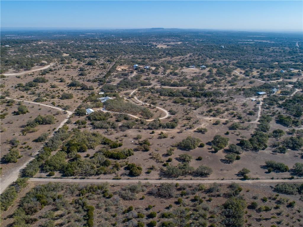 Here is your chance to own your own piece of Texas in the highly desired area of Round Mountain! This is 12 acres in a gated communitywith VERY LIGHT restrictions! On the back of the property you have large views of the hill country and even views of the 'RoundMountain'. This acreage is located on the desired FM 962. The pictures do not do the views justice!! Don't miss out on this opportunity.The seller will be putting light restrictions on the property such as no mobile homes & no commercial use