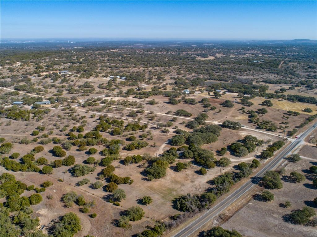 Here is your chance to own your own piece of Texas in the highly desired area of Round Mountain! This is 12 acres in a gated community with VERY LIGHT restrictions! On the back of the property you have large views of the hill country and even views of the 'RoundMountain'. This acreage is located on the desired FM 962. The pictures do not do the views justice!! Don't miss out on this opportunity. The seller will be putting light restrictions on the property such as no mobile homes & no commercial use