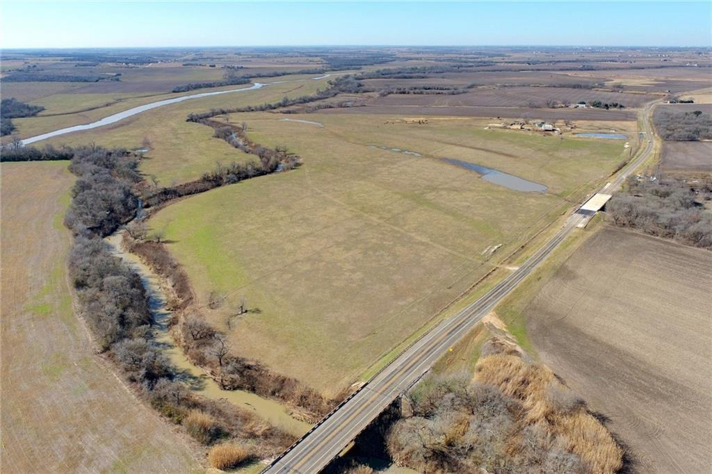 Beautiful farm land (AG exempt) with significant County Road frontage. Bordered by Brushy Creek, panoramic views and several gorgeous homesites. Minutes to Taylor, Round Rock and Toll Road 130 makes for easy and quick commute to Austin and Georgetown. Exemplary Thrall ISD and more~