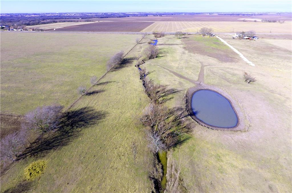 Beautiful 20 acres right on 973 in the Taylor ETJ. NO RESTRICTIONS on the property. Subdivide and build, put in an RV park, storage facility, your own dream home, whatever your heart desires. Commercial driveway installed.