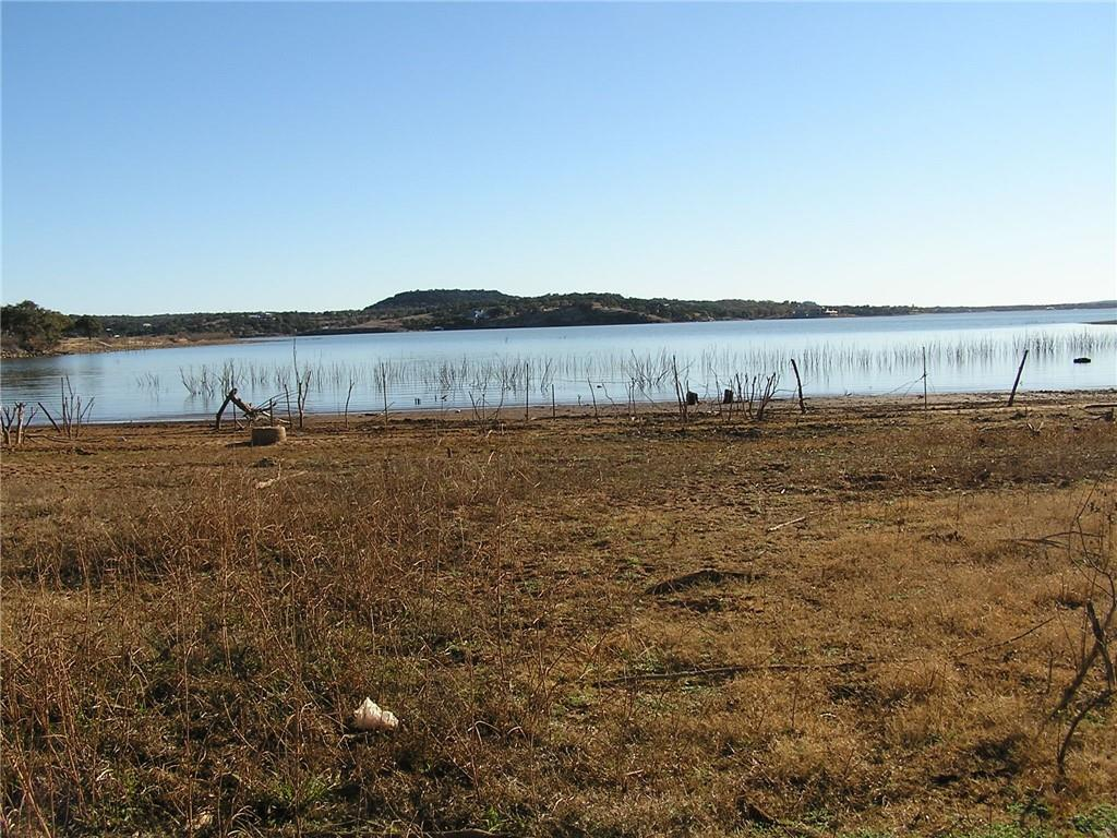 Great waterfront property with sandy beaches on the open water of Lake Buchanan.  Approximately 700 feet of waterfront.  Huge live oak and pecan trees.