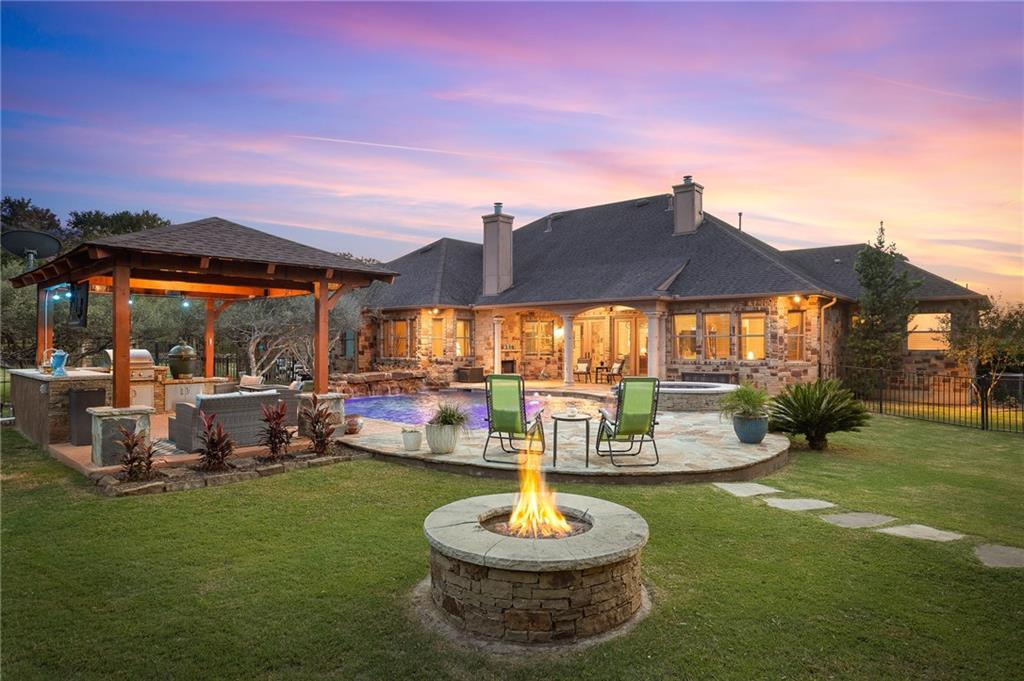 Offer Deadline:  Seller will review all offers on Monday at 4:00 pm.  (1/18) Stunning 1.445 acre estate in the esteemed gated community, Elliott Ranch in Buda. This custom built 1 story home has elegant touches from luxury flooring to the designer ceilings. Dedicated office is located through the french doors off the foyer Formal living has gorgeous fireplace and french doors leading to the backyard oasis. Stone accent wall leads to the gourmet chef's kitchen. Built in cappuccino machine, wine fridge and storage, prep sink, and farmhouse sink are a few of the highlights! Overlook the breakfast area and 2nd living area from the kitchen. 3 spacious secondary rooms share one side of the home. Jack and Jill bath connects the 2 back bedrooms. The 4th bedroom does not have a closet and was previously used as a media room. Full bath and hall closet are next to this room for a full private bath and storage. Owner's suite is situated on the other side of the house for extra privacy. His/her closets, garden tub, and walk in shower add to this luxurious en suite bath. Casita in the backyard has an extra large storage closet, full bath and a mini kitchenette with a sink, microwave, and fridge. A storage/garage is located behind the casita, perfect for a riding mower or tool shed! Pool is the perfect spot to relax all summer! Outdoor kitchen has a built-in grill, counter space for a bar, and plenty of seating for entertaining! This gorgeous lot is surrounded by trees creating a private resort-like ambience in your backyard.
