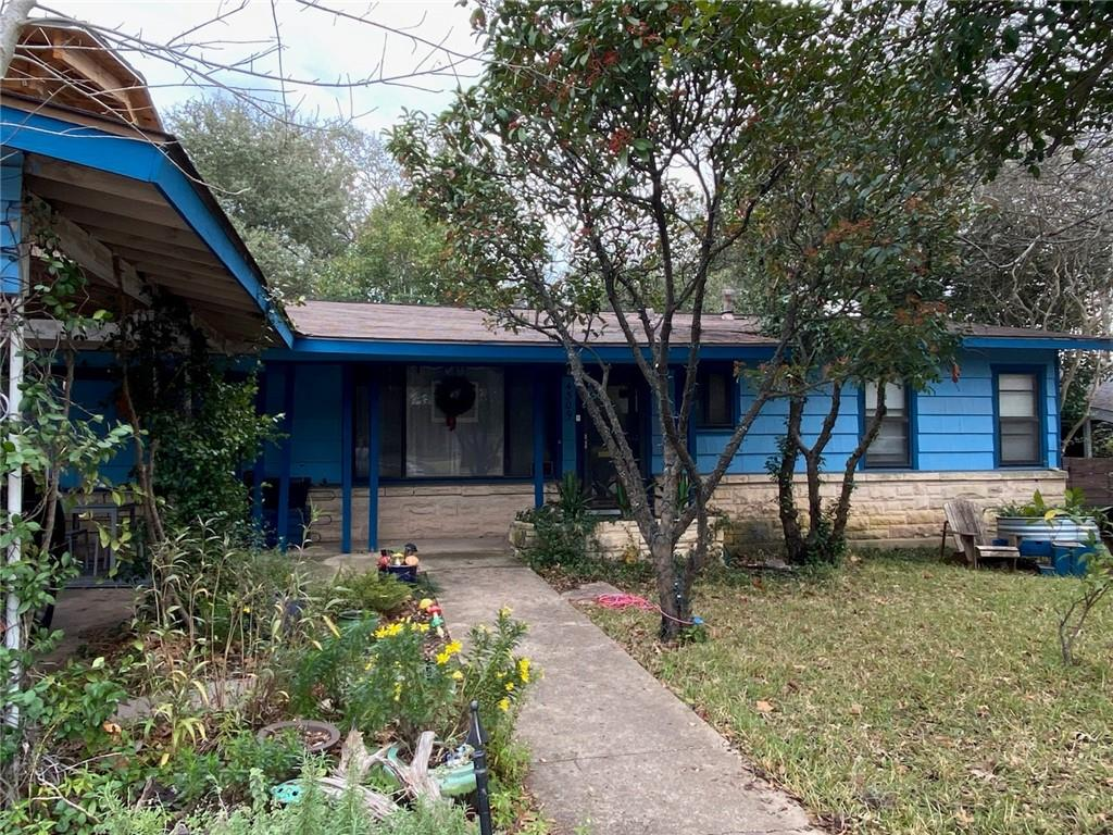Location is CENTRAL.  Area is going through a re-birth with older homes removed and new ones being built.  Mature landscape.  Wood floors.  Renovate or build new - don't miss this opportunity.  Waiting for you to add more charm to this already unique home.  Easy access to MoPac - 10 minutes to downtown, 10 minutes to Domain, 15 minutes to Mueller.  Across from the new Grove Development.  Washer/dryer will convey with home.