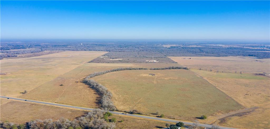 If you are looking for a great cow place, this is it, with some of the best native grass in the county for grazing.  There is fenced hay meadow at the northeast corner to compliment your grazing.  With frontage on Hwy 183 south and two entrances, it has easy access.  Wooden cattle pens are at the highway second entrance.  A seasonal creek and a water well provide water for your livestock.  C